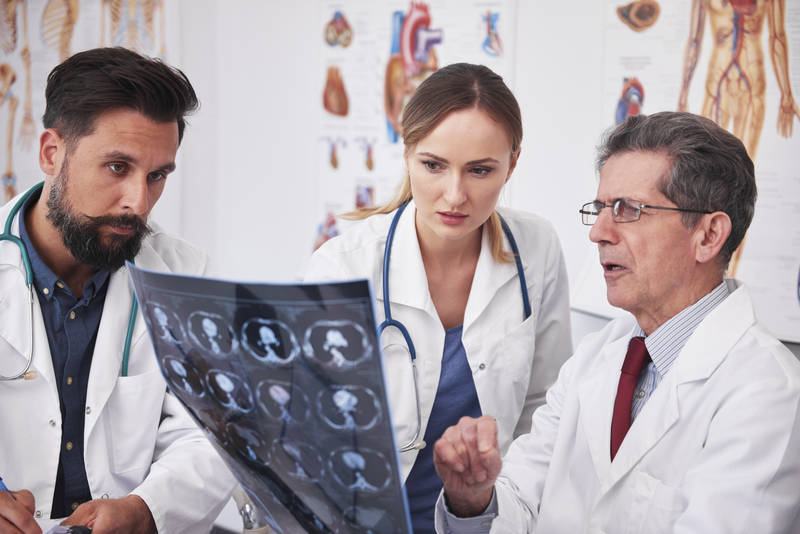 Doctors discussing medical chart